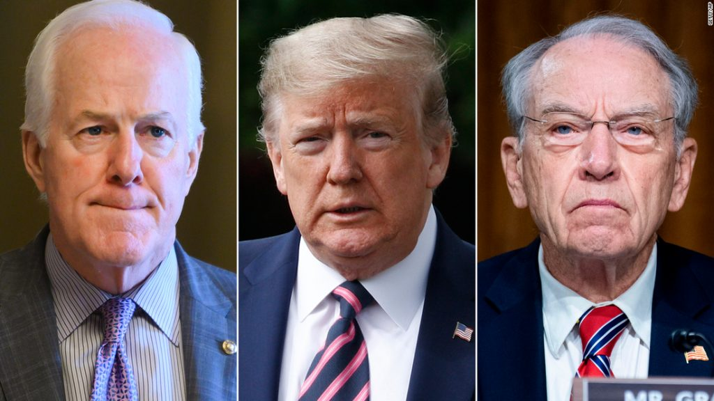 At left, Sen. John Cornyn of Texas; at center, President Donald Trump, and at right, Sen. Chuck Grassley of Iowa. All men pictured are Republicans.