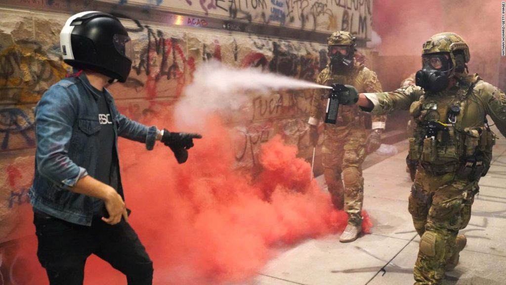 Portland mayor teargassed after joining protesters