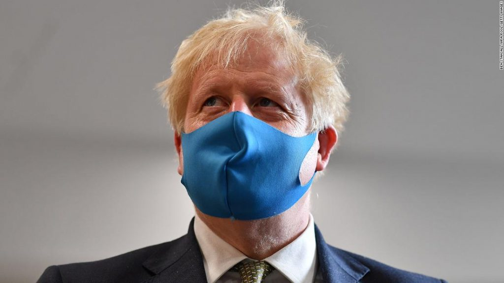 UK Prime Minister Boris Johnson wears a face mask as he visits Tollgate Medical Centre in London on July 24, 2020.