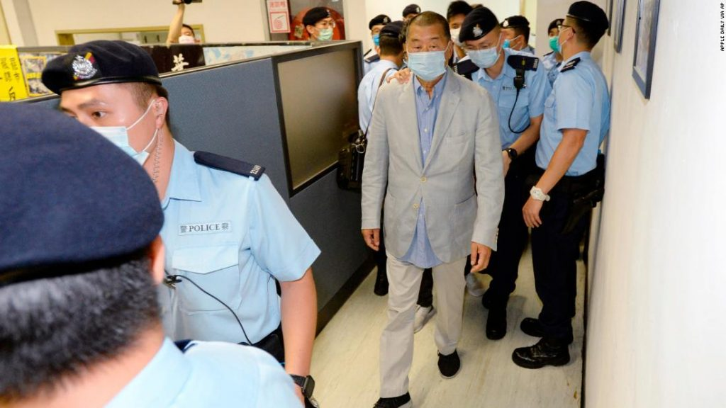 Police lead Hong kong pro-democracy media mogul Jimmy Lai (C), 72, away from his home after he was arrested under the new national security law in Hong kong on August 10, 2020.